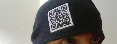 Knit cap with embroidered QR code.