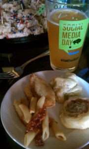 Photo of pint glass and food from the event.