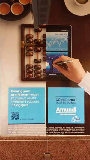 Wall ad for Amundi Asset Management featuring a QR code.