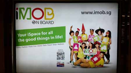 Wall ad for iMOB featuring a QR code.