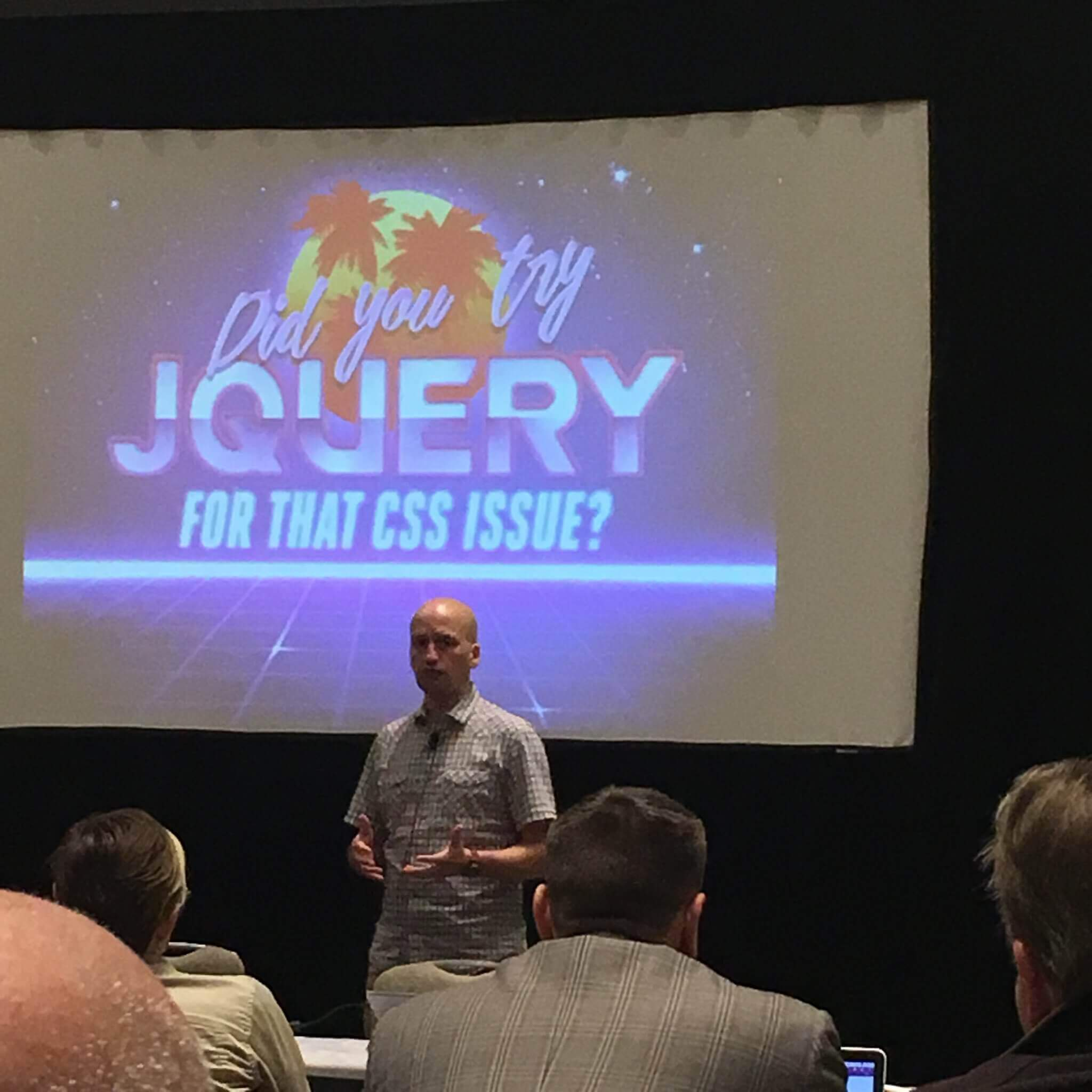 "Slide with text: ""did you try jquery for that css issue?"" With retro graphics"