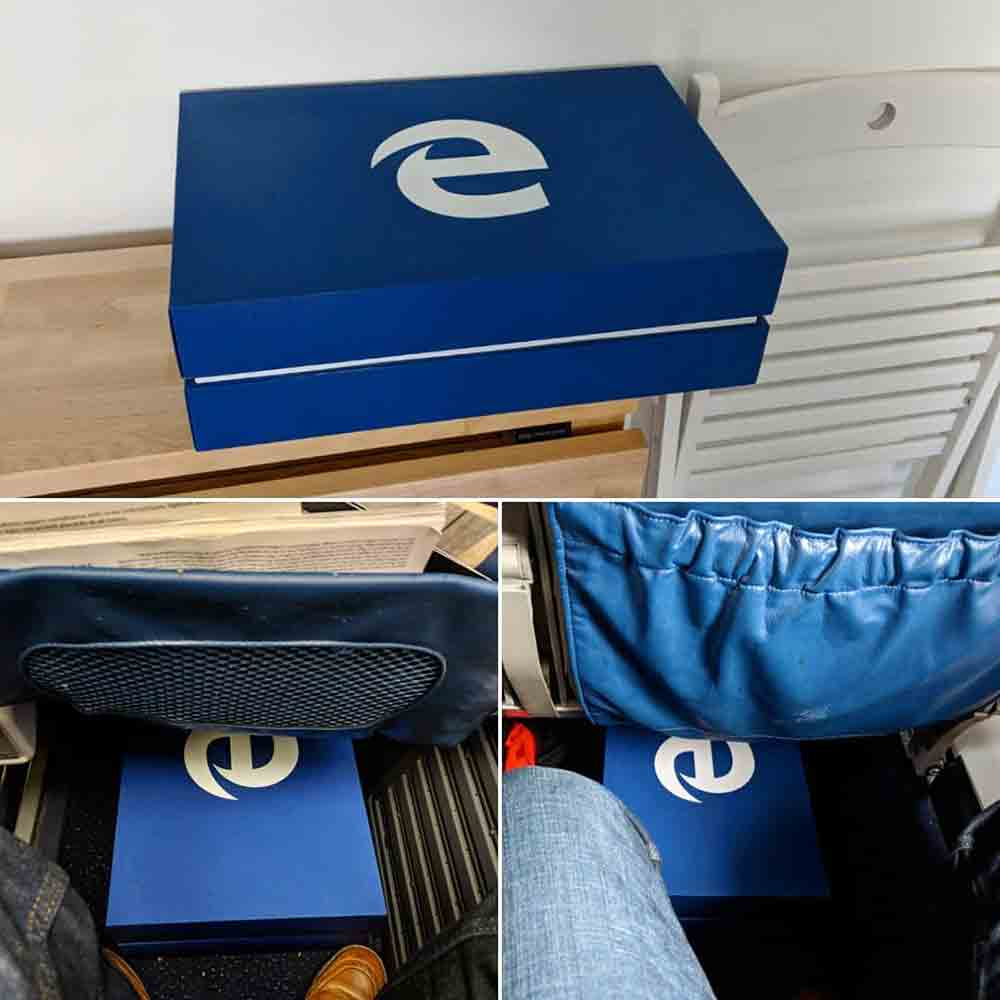 A large blue box (5½ × 16½ × 12 inches) with the white Microsoft Edge logo. Two images show the box under the seat on two different airplanes. A third image shows the box on my kitchen table.