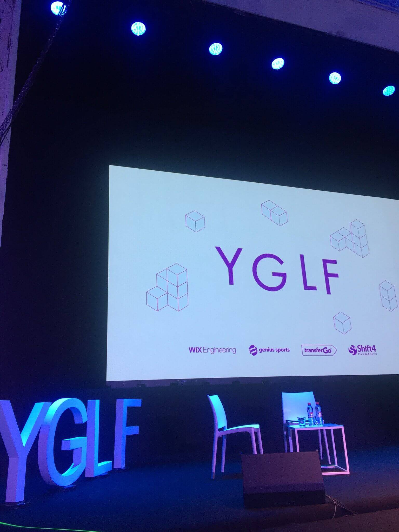 The YGLF placeholder slide used throughout the day.
