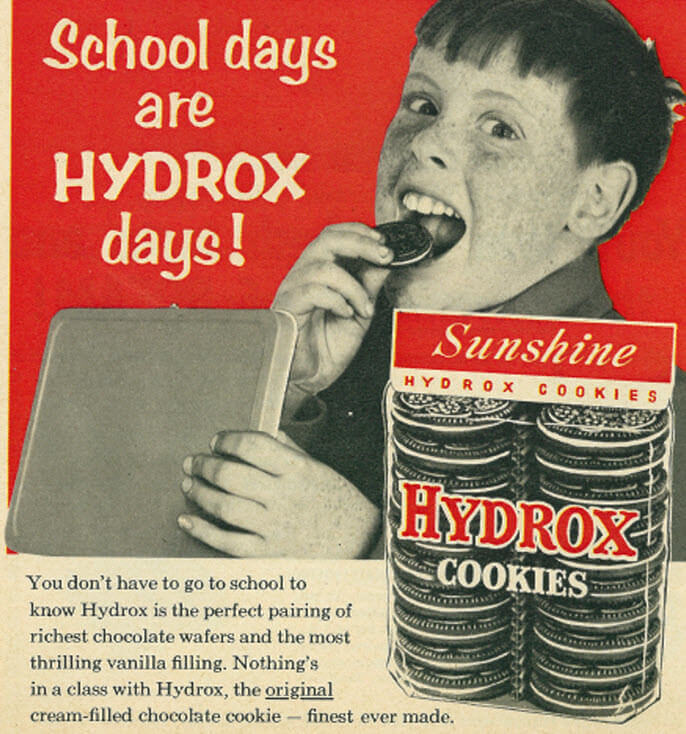 "Child eating cookie from lunch box with text ""School days are HYDROX days!"""