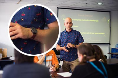 Me conducting a workshop, with an enlarged view of the watch on my wrist.