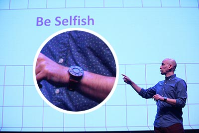 Me on stage at a conference, with an enlarged view of the watch on my wrist.