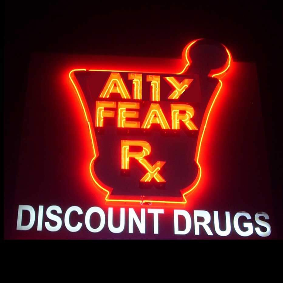 A discount drugs sign, that in neon reads A11y Fear.